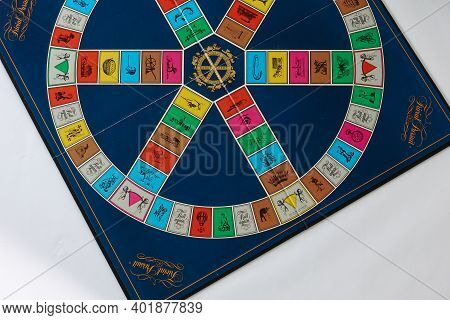 Trivial Pursuit Game Set Up To Play Which Is A Board Game Where Winning Is Determined By A Player's