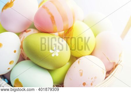 Easter Basket Filled With Painted Easter Eggs. Colorful Painted Easter Eggs In Basket.