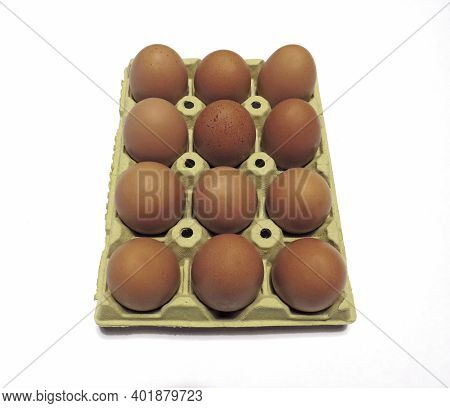 Aerial View Of A Dozen Ecological Eggs In Recyclable Cardboard. Free-range Eggs On Packaging Isolate