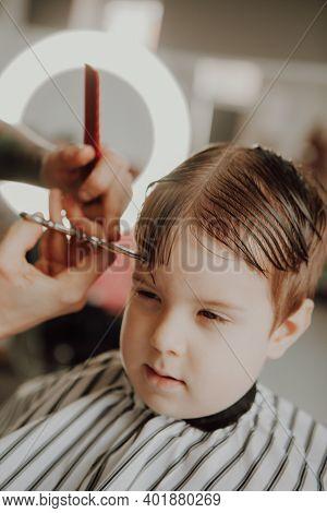 The Work Of The Barbershop. Haircut Of A Boy In A Barbershop. Children\\\'s Haircut