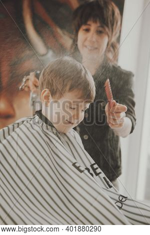 The Work Of The Barbershop. Haircut Of A Boy In A Barbershop. Children\'s Haircut