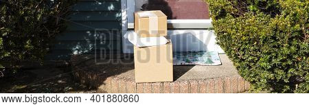 Packages Delivered And Dropped Off On A Residential House Front Stoop Left Out In The Open For All T