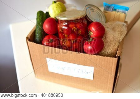 Box For A Charity Donation With Food. Canned Food, Pasta, Pickled Tomatoes, Vegetable, Rice. Food De