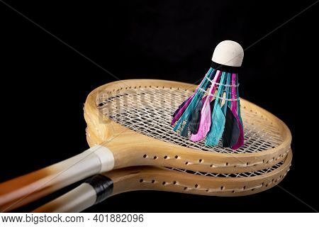 Badminton Shuttlecocks And Wooden Paddles. Accessories For Amateur Games During The Holidays.