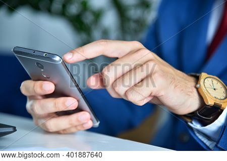 Businessman Hands Using Smart Phone. Investment And Technology Concept. Close Up