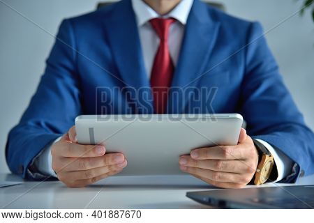 Businessman In Office Using Digital Tablet. Business And Management Concept. Close Up