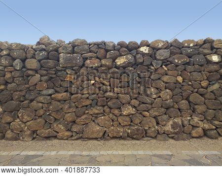 Dry Stone Wall To Prevent Landslides, Floods And Avalanches. Inca Wall With Blue Sky Background. Dec