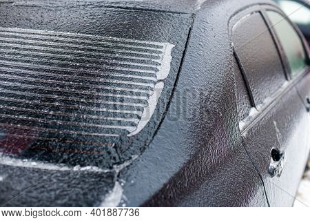 Part Of The Rear Window Of A Car With Heating Filaments Covered With Ice At A Shallow Depth Of Field