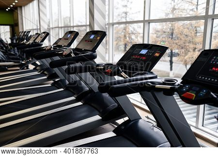 Treadmills In A Modern Gym And Fitness Center With Equipment And Exercise Machines.