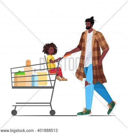African American Father With Little Daughter In Trolley Cart Buying Groceries In Supermarket Fatherh
