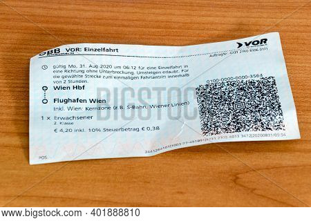 Pruszcz Gdanski, Poland - September 19, 2020: Tickets To Vienna Airport On Wooden Table.