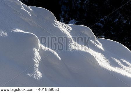 Some White Snowdrifts On A Slope In A Sunny Day