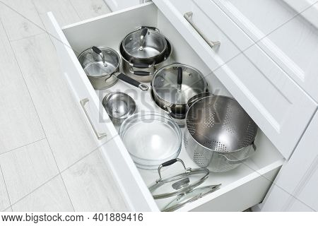 Open Drawer With Pots And Pan Indoors. Order In Kitchen