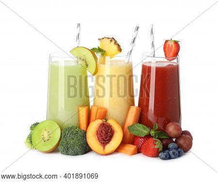 Glasses Of Delicious Juices And Fresh Ingredients On White Background