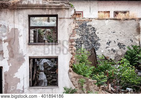 Outdoor Facade Of The Ruins Of A Demolished Residential Building Decaying In An Urban Environment In
