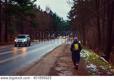 Person Walking Away Along A Country Road On A Damp Autumn Day, Moscow Region, 29.12.2020