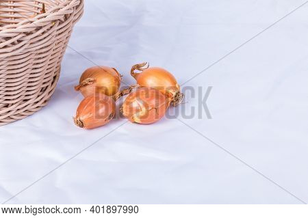 Shallot In A Wicker Basket On A White Background