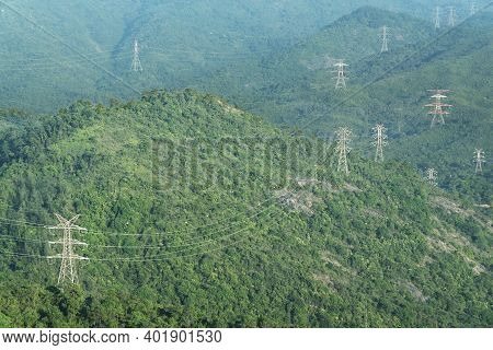 Electric Pylon And Electric Line On Mountain In Hong Kong