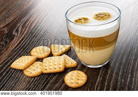 Different Cookies, Transparent Glass With Latte-macchiato On Dark Wooden Table