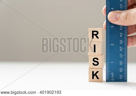 Measure The Word Risk With Blue Color Ruler For Risk Assessment Concept