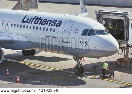 BUDAPEST, HUNGARY - CIRCA 2017: Lufthansa Airbus A320 airliner arriving at Budapest. About to be connected to jetbridge for boarding. Lufthansa is the biggest airline of Europe