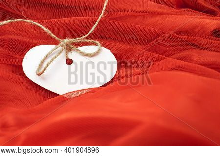 On The Red Tulle Material There Is A Tag For The Price Tag In The Form Of A White Heart. Price Tag G