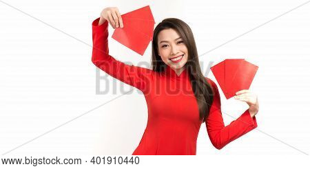 Asian Girl In Vietnamese Ao Dai Dress With Red Envelope Isolated On White Background