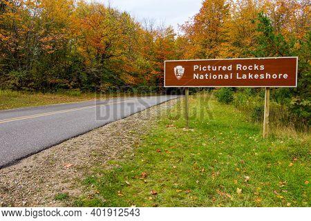 Munising, Michigan, Usa - October 3, 2020: Beautiful Vibrant Lush Fall Foliage Surround The Entrance