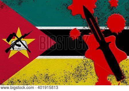 Mozambique Flag And Black Tactical Knife In Red Blood. Concept For Terror Attack Or Military Operati
