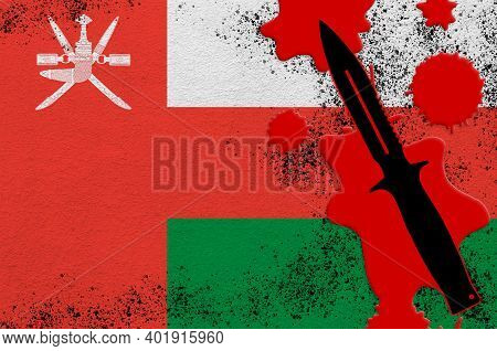 Oman Flag And Black Tactical Knife In Red Blood. Concept For Terror Attack Or Military Operations Wi