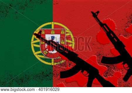 Portugal Flag And Two Black Ak-47 Rifles In Red Blood. Concept For Terror Attack Or Military Operati