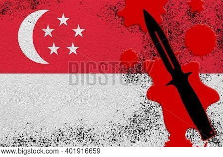 Singapore Flag And Black Tactical Knife In Red Blood. Concept For Terror Attack Or Military Operatio