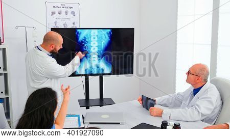 Expert Doctor Holding Medical Training Using Modern Technology, Presenting Digital Radiography To Co