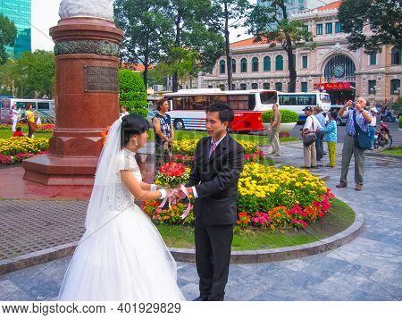 Hanoi, Vietnam - February 11, 2011: Photographer Takes Photos After Wedding In City Of Hanoi, Vietna