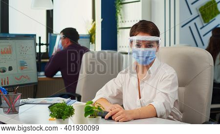 Businesswoman With Visor And Mask Talking In Front Of Camera Having Video Call With Partners. Pov Of