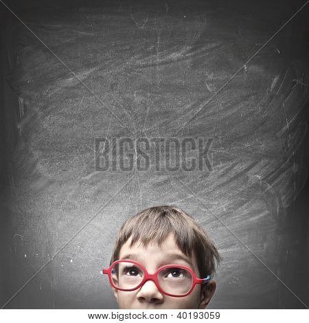 Child with an empty blackboard over his head