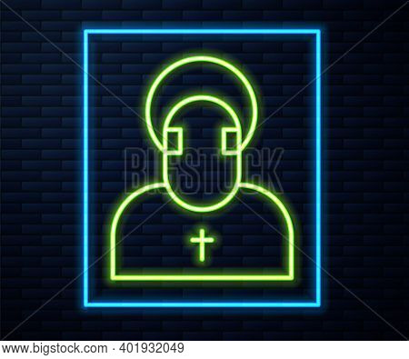 Glowing Neon Line Monk Icon Isolated On Brick Wall Background. Vector