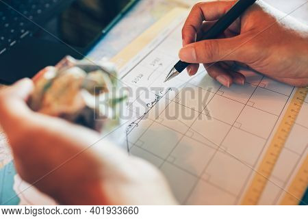 Tourist Hold Pen And Planning Vacation With Calendar And Map. Cross Line In Holiday Text And Crump P