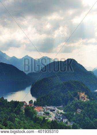 Misty Day In The Bavarian Alps Near Fussen, Germany. Alps And Lakes In A Summer Day In Germany. Take