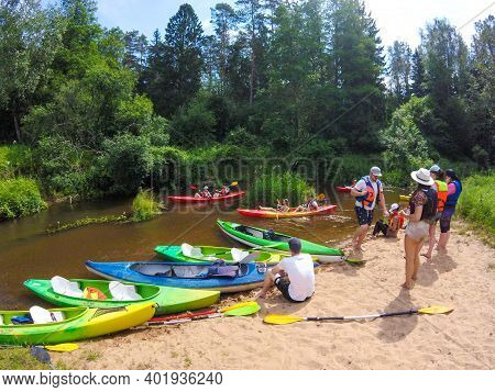 Vilnius, Lithuania - June 23 2020: Canoeing In Lithuania, View From The Canoe, People On The Beach W