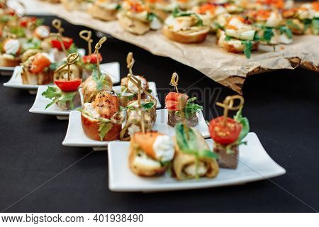 Festive Buffet. An Assortment Of Cold Cuts And Canapes On Wooden Skewers. Cocktail Reception At The