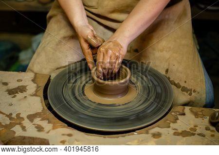 Creating A Jar Or Vase Master Crock. The Sculptor In Workshop Makes Jug Out Of Earthenware Closeup.
