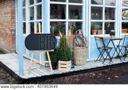 Exterior Winter Terrace Of House. Decor Spring Yard. Wooden Porch Home In Christmas Trees. Live Chri