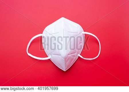N95 Respiratory Medical Face Mask On Red Background, Prevent Coronavirus Disease (covid-19) And Pm2.