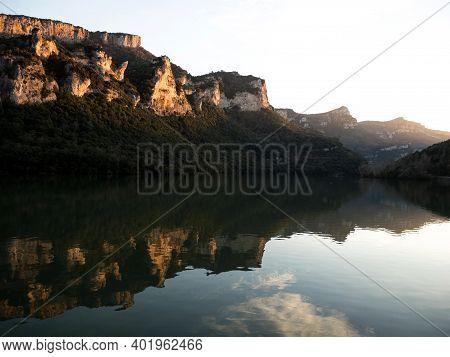 Reflection Of Mountains In Ebro River Lake Dam Embalse De Sobron On Border Of Basque Country Castile