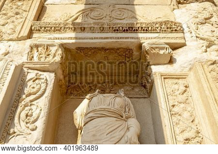 Headless Figure On Library Wall In Ephesus Ancient City