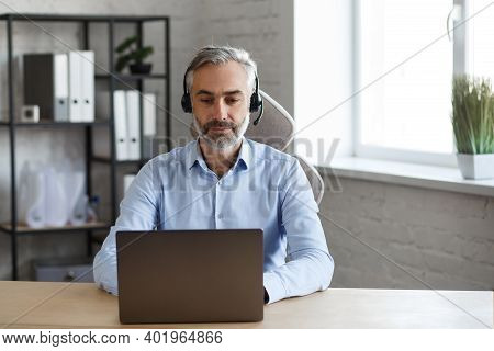 Online Education, Remote Working, Home Education. Portrait Of Grey-haired Senior Handsome Man Teachi
