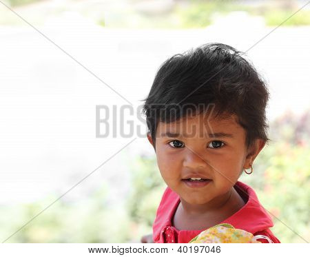 Photo Of Pretty And Happy Indian Girl Child With Curious But Satisfied Expression On The Face; And A