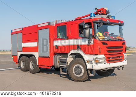 Red Fire Truck On The Airport Runway With Equipment For Firefighting Operations