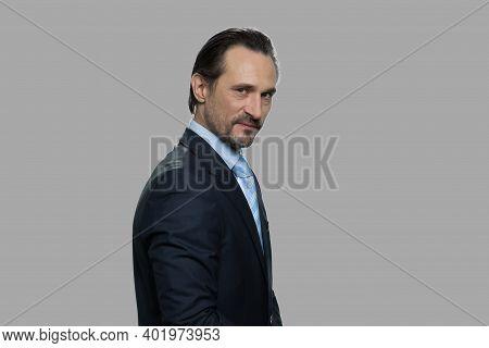 Dissatisfied Businessman Is Expressing Mistrust. Distrustful Sceptical Middle-aged Businessman Looki